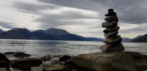 Balanced stack of stones near lakeside
